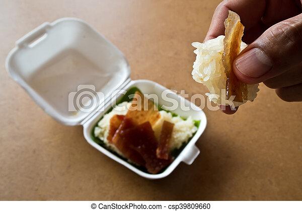 Sticky rice and Roast pork in foam box - csp39809660