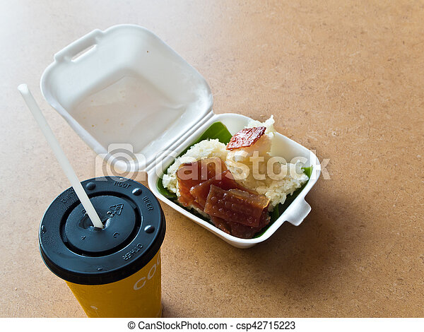 Sticky rice and Roast pork in foam box - csp42715223