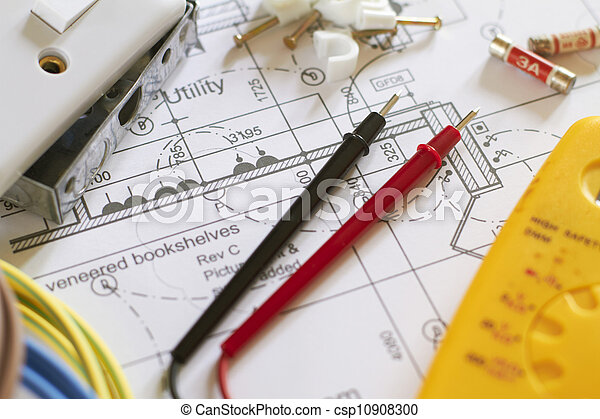 Still Life Of Electrical Components Arranged On Plans - csp10908300
