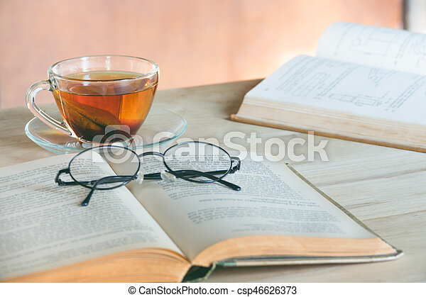 Still life tea time with book - csp46626373