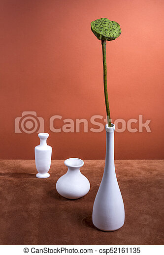 Still Life With A Lotus Flower Without Petals And White Vases