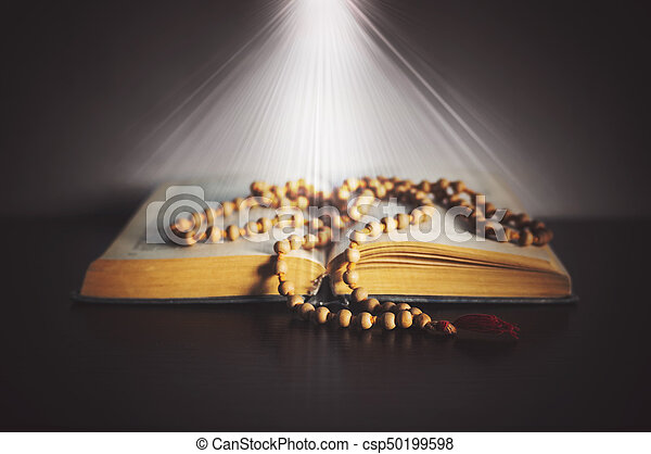 still life with books and rosary