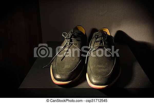 still life with men's leather boots shoes on the box - csp31712545