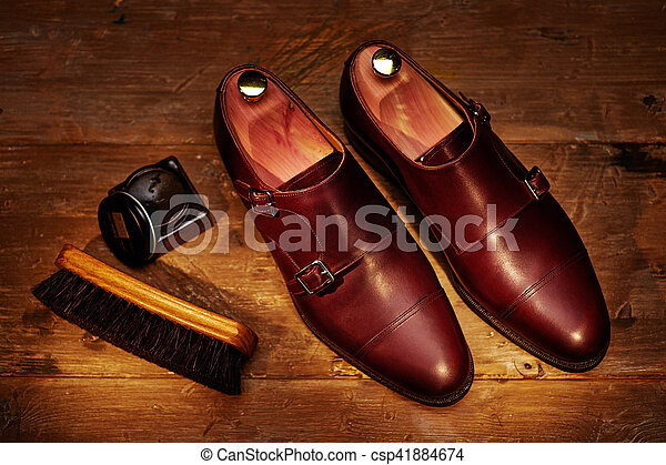 Still life with men's leather shoes and accessories for shoes ca - csp41884674
