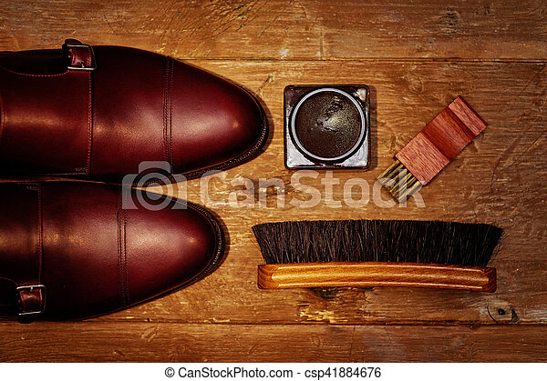 Still life with men's leather shoes and accessories for shoes care. - csp41884676