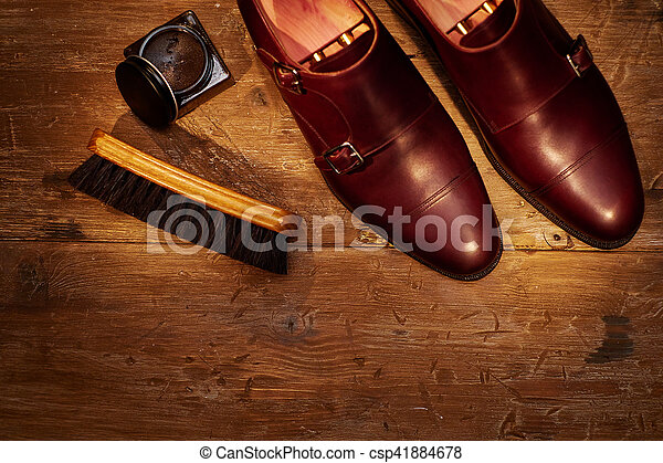 Still life with men's leather shoes and accessories for shoes ca - csp41884678