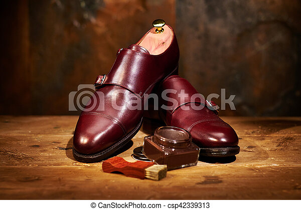 Still life with men's leather shoes and accessories for shoes ca - csp42339313