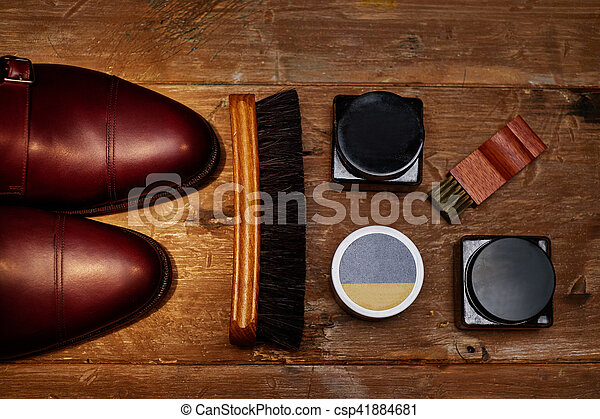 Still life with men's leather shoes and accessories for shoes care. - csp41884681