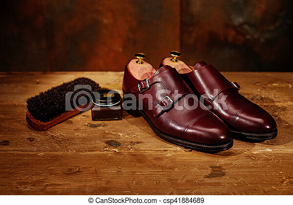 Still life with men's leather shoes and accessories for shoes ca - csp41884689