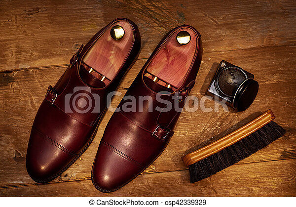 Still life with men's leather shoes and accessories for shoes ca - csp42339329