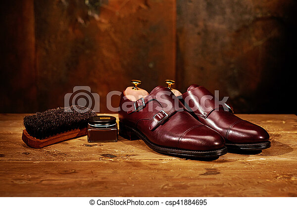 Still life with men's leather shoes and accessories for shoes ca - csp41884695