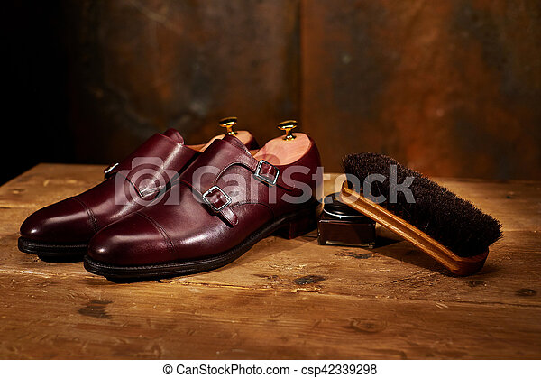 Still life with men's leather shoes and accessories for shoes ca - csp42339298