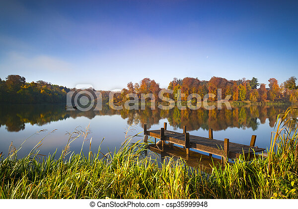 Still waters of a lake in autumn - csp35999948