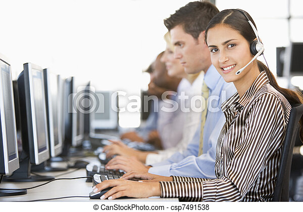 Stock Traders With Headsets At Work - csp7491538
