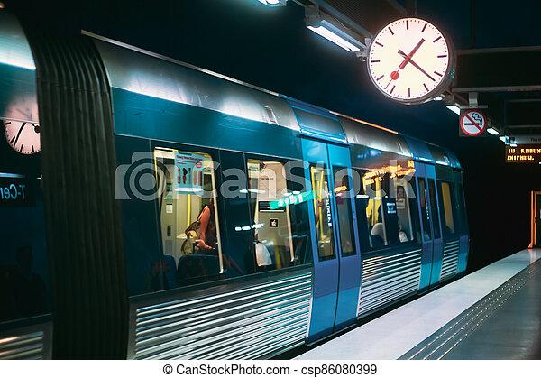 Stockholm, Sweden. Modern Illuminated Metro Underground Subway Station With Train - csp86080399