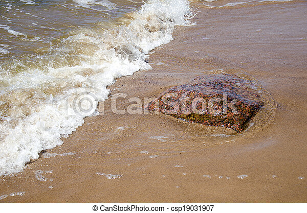 stone and sea wave on beach - csp19031907