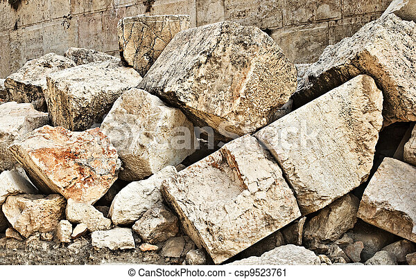 Stone blocks from section of wall surrounding Temple mount (Wailling wall) destroyed by roman soliders - csp9523761