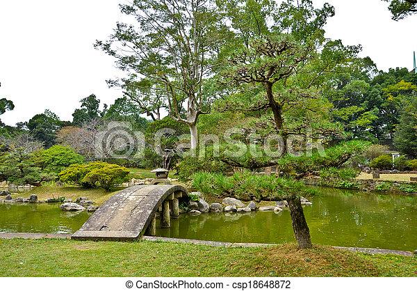 stone bridge in japanese garden at isahaya japan stock photo - Japanese Garden Stone Bridge