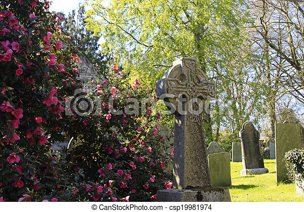 Stone Cross and spring blossom - csp19981974