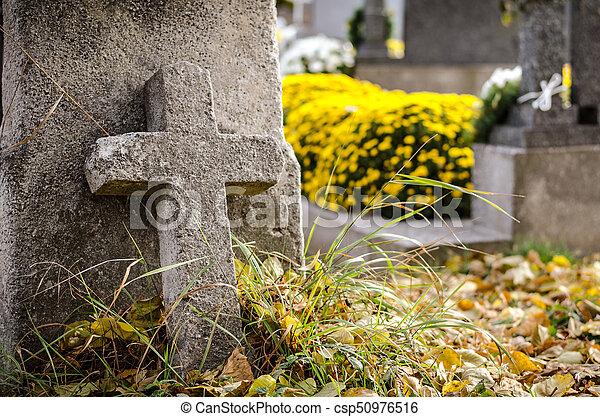 stone cross at cemetery - csp50976516