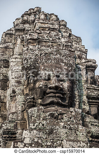 Stone head on towers of Bayon temple in Angkor Thom, Cambodia. South East Asia. Tradition, Culture and Religion. - csp15970014