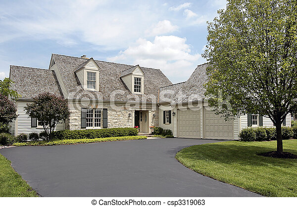 Stone home with cedar roof - csp3319063