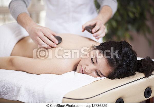 Stone massage at a health spa - csp12736829