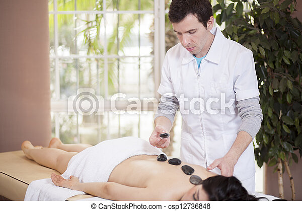 Stone massage at a spa - csp12736848