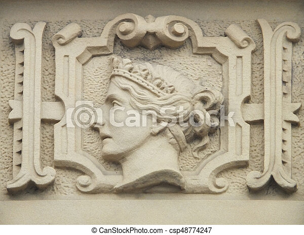 stone relief carving of queen victoria on an old building - csp48774247