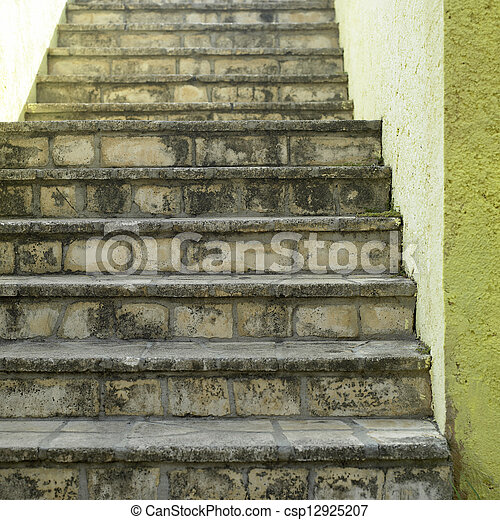Stone stairs and yellow wall - csp12925207