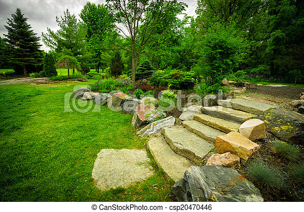Stone Stairway On A Lush Green Garden Path The Natural Stone Steps Of A Stairway Garden Feature Climb A Small Hill In A Lush Canstock