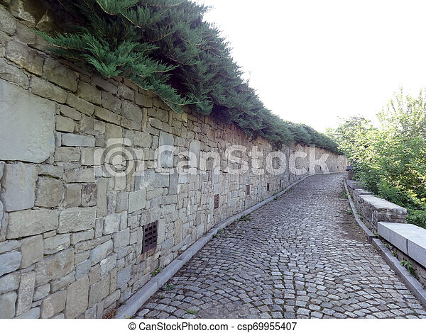 Stone Wall and a Path - csp69955407