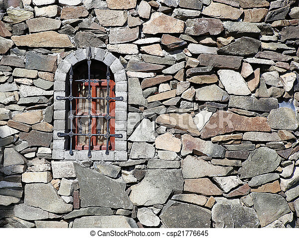 stone wall of fortress with window - csp21776645