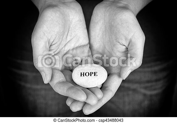 Stone with the word Hope in the woman's palms - csp43488043
