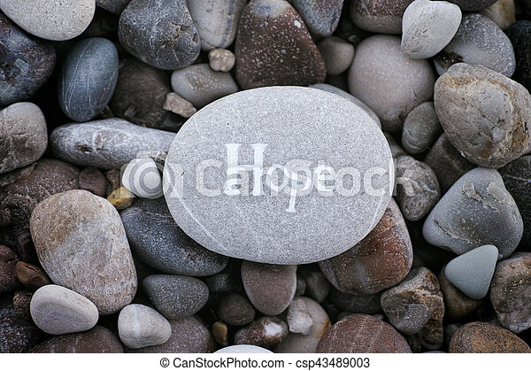 Stone with the word Hope on stone background - csp43489003