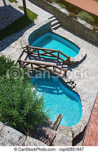 Stone yard with pool.