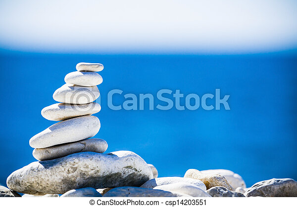 Stones balance, pebbles stack over blue sea in Croatia. - csp14203551
