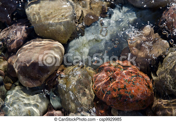 Stones in clear water - csp9929985