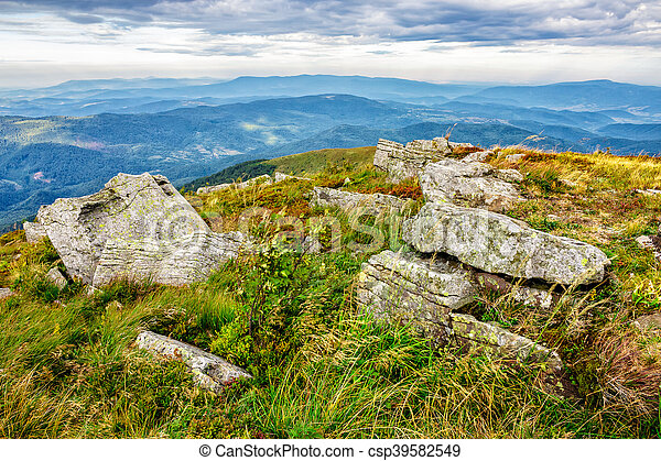 stones in valley on the edge of mountain range - csp39582549