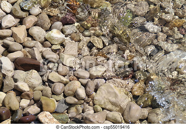 Stones under the surface of water - csp55019416