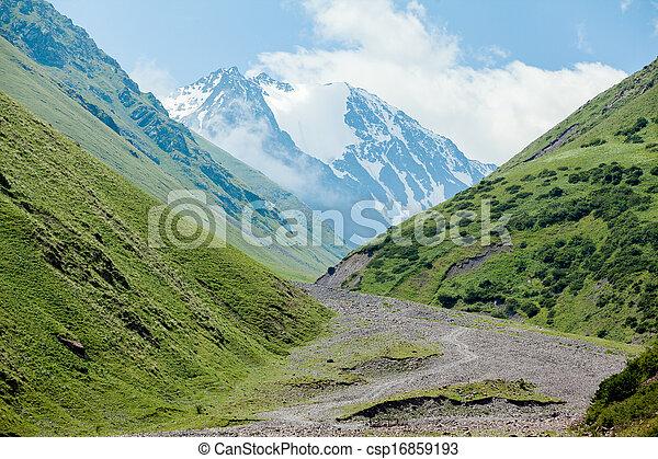 Stony road and white mountain peak - csp16859193