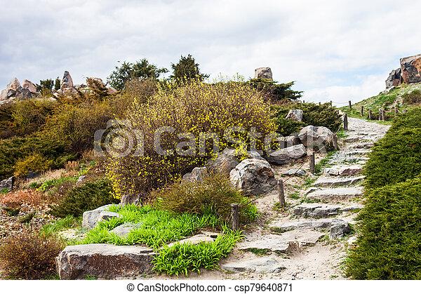 Stony stairs in the rockery in Kyiv botanical garden - csp79640871