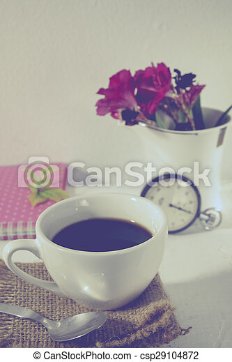 stopwatch and flowers in a cup still life romantic background with