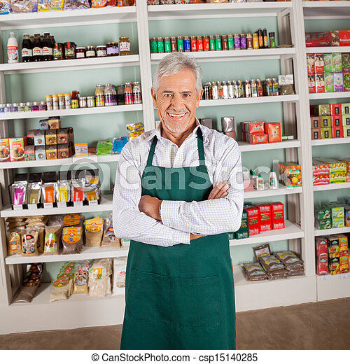 Store Owner Smiling In Supermarket - csp15140285