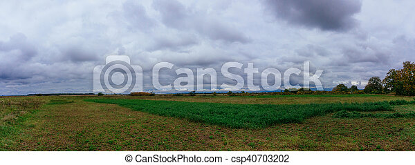 Storm Clouds over prairie field - csp40703202