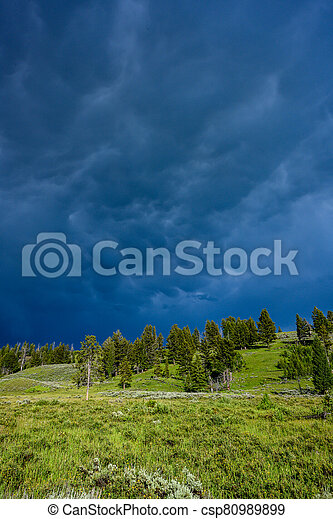 Storm clouds roll in over Yellowstone hill - csp80989899