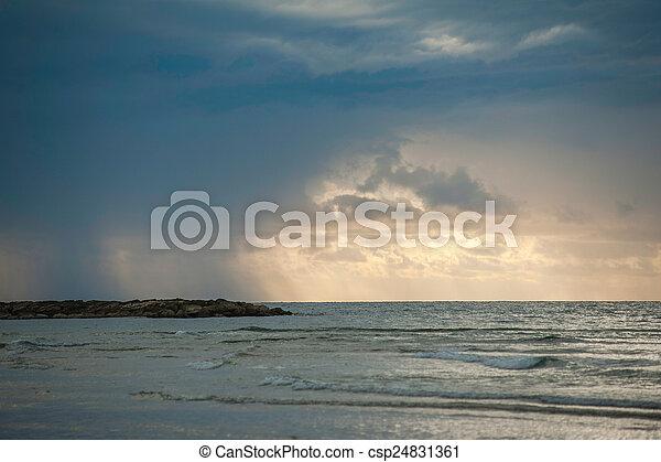 storm on the beach - csp24831361