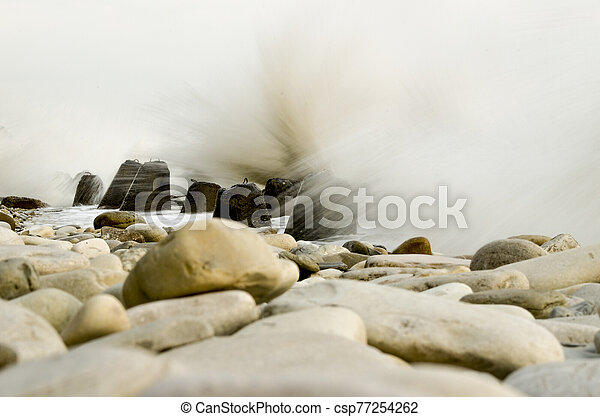 Storm on the beach with a long exposure - csp77254262