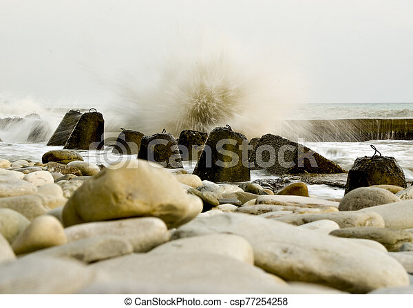 Storm on the beach with a long exposure - csp77254258
