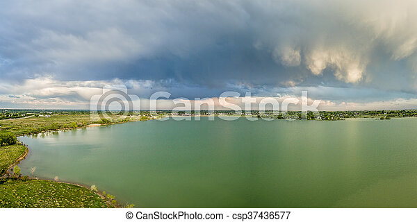 Stormy clouds over lake - csp37436577